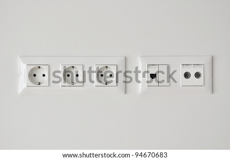 electrical, ethernet and tv or radio socket on the wall - stock photo