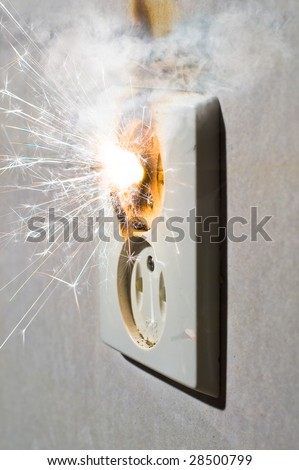 Electrical failure causing short circuit in power outlet - stock photo