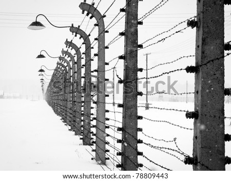 Electrical fence around Auschwitz concentration concentration camp - stock photo