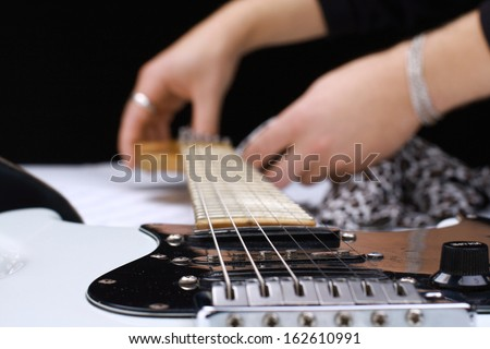 Electrical guitar on a white background - stock photo