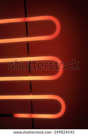 Electrical heating element of an electrical barbeque grill glowing in the dark. - stock photo