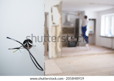 Electrical installations in an appartment being rebuilt - stock photo