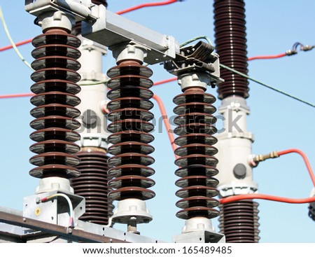 Electrical insulators inside a high-voltage power station - stock photo