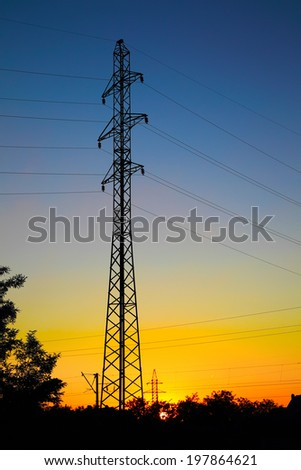 Electrical mast on the red sunset background