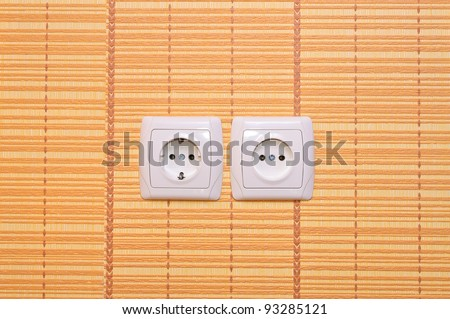 Electrical outlet in the wall - stock photo