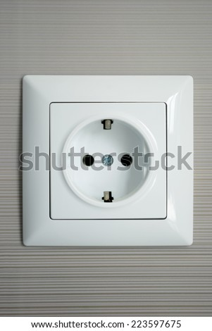 Electrical outlet installed on a gray background - stock photo