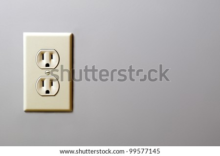 electrical outlet on a wall - stock photo