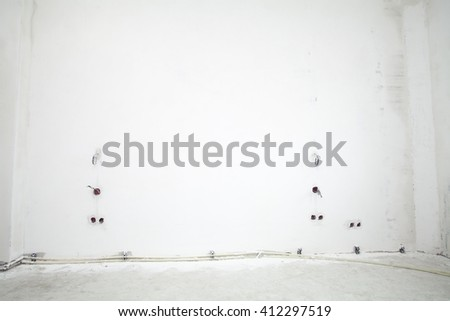 Electrical outlet on a white wall, background, repair - stock photo