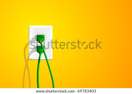 Electrical outlet with two green plugs and lots of copy space on the right. - stock photo