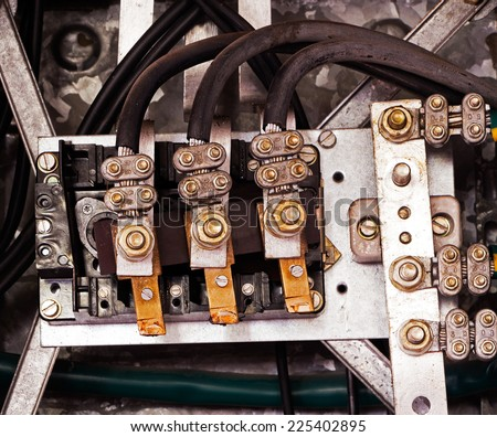 Electrical panel and cables in an old factory - stock photo