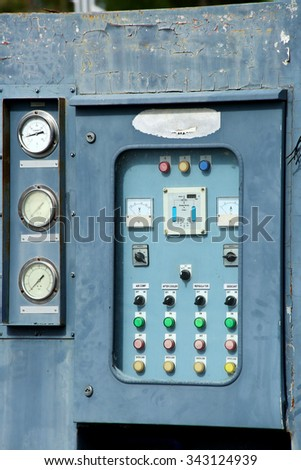Electrical panel at a assembly line factory. Controls and switches - stock photo