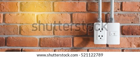electrical plugs in wall outlet with light tone