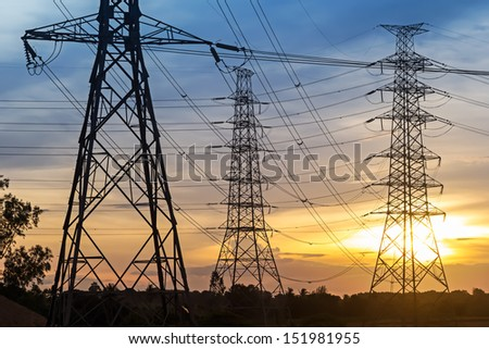 Electrical pole with sunset background.