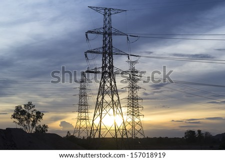 Electrical pole with sunset background. - stock photo