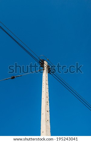 Electrical pole with wire on blue sky, Thailand - stock photo