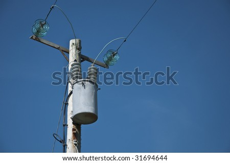 electrical power line and transformer - stock photo