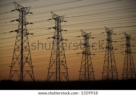 Electrical power lines at dusk - stock photo