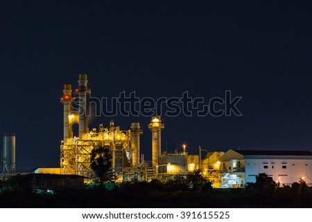 Electrical power plant (possibly gas turbine power plant) at night - stock photo