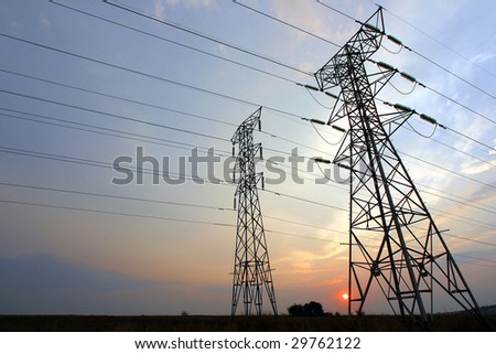 Electrical power Pylons at sunrise - stock photo
