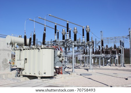 Electrical power transformer in high voltage substation. - stock photo