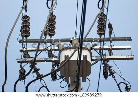 Electrical power transformer on electric pole - stock photo