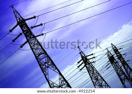 electrical powerlines with menacing sky - stock photo
