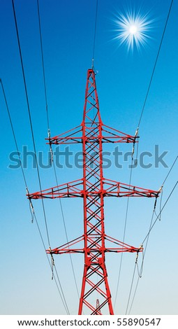 Electrical pylon on a background of the clear blue sky. - stock photo