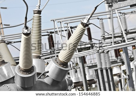 Electrical substations have large connectors to handle the voltage. - stock photo