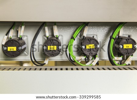 Electrical switches and wires on control panel - stock photo