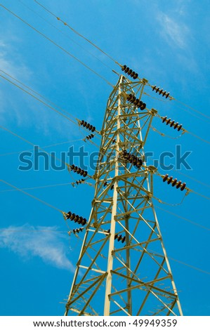 Electrical tower on a background of the clear blue sky.