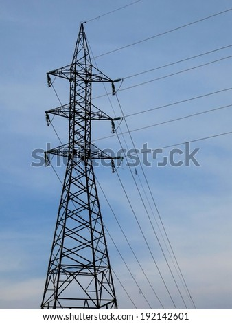 Electrical tower transmissions wires blue sky Brazil.