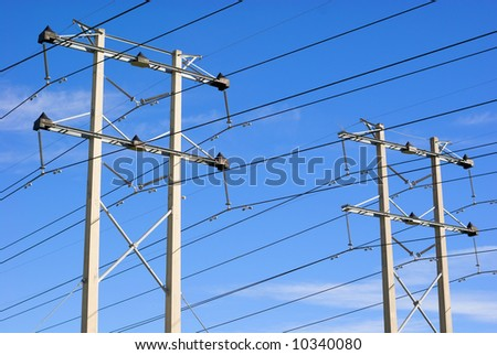 Electrical transmission towers and power lines. - stock photo