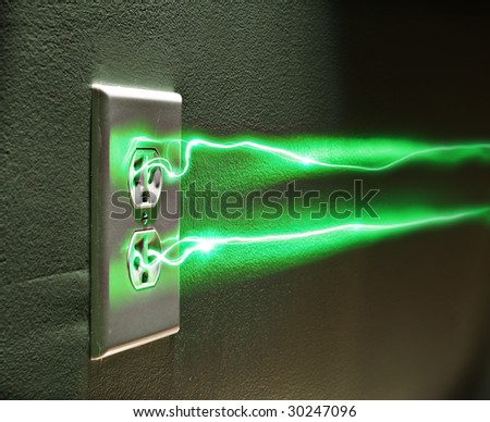 Electrical wall socket with green energy or electricity - stock photo