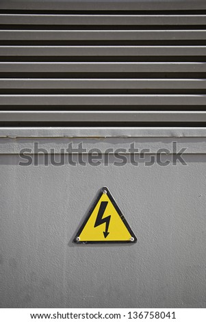 Electrical warning sign, detail of information on the city, textured background hazard information - stock photo