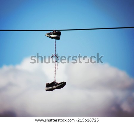 electrical wire against a blue sky with clouds - stock photo