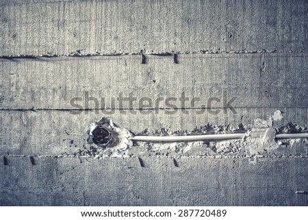 electrical wires and installation of cables in cement walls at construction site. soft effect on photo - stock photo