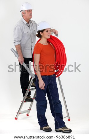 Electrician and female trainee