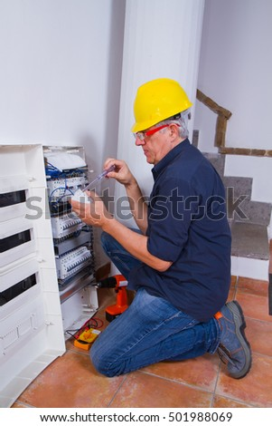 electrician at work with a panel