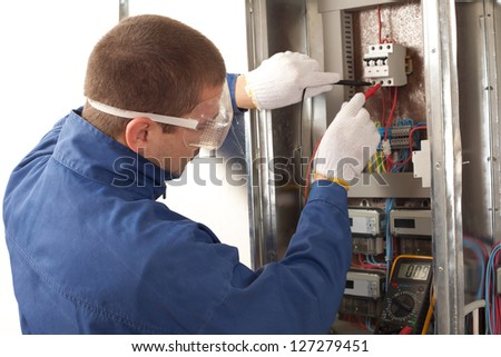 stock photo electrician checking fuse box using a digital multimeter 127279451 digital multimeter stock images, royalty free images & vectors how to check fuse box with multimeter at gsmx.co