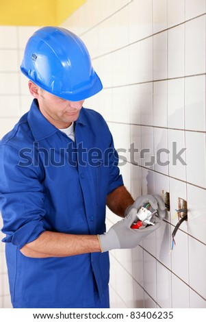 electrician connecting an electrical outlet