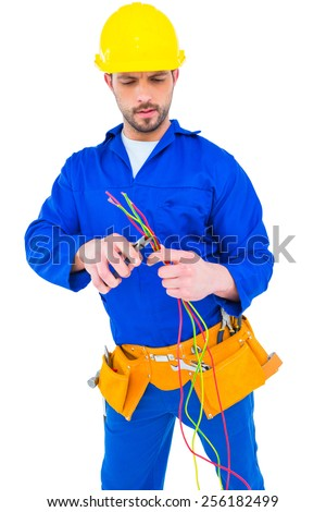 Electrician cutting wire with pliers over white background - stock photo