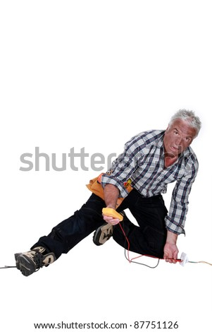 electrician falling down after an electrical shock - stock photo