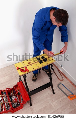 electrician fixing breaker box