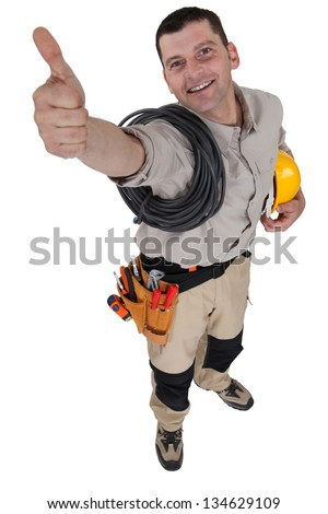 Electrician giving the all-clear - stock photo