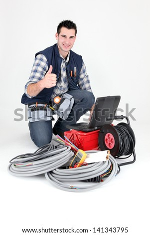Electrician giving the thumb's up - stock photo