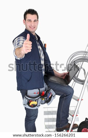 Electrician giving thumbs-up - stock photo