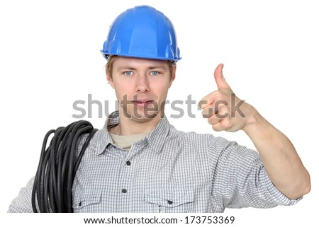 Electrician giving thumbs up - stock photo