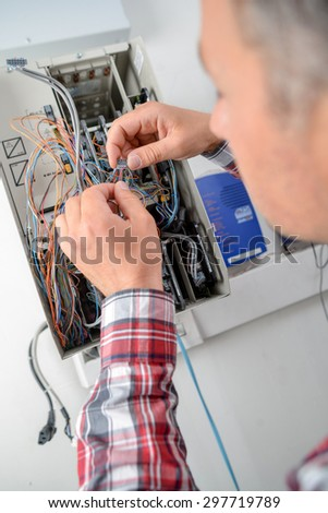 Electrician has got his work cut out - stock photo