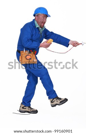 electrician having an accident - stock photo
