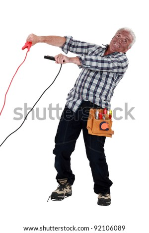 electrician hit by the electric current - stock photo